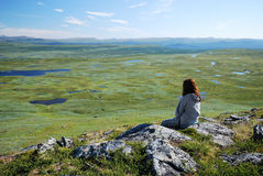 Woman against the tableland with many lakes. Stock Photography
