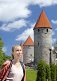 The woman against towers of a city wall in Tallinn. Estonia Stock Image