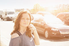 Woman against traffic Royalty Free Stock Photo