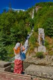 Woman against waterfall in  Borjomi town central park Stock Images