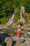 Woman against waterfall in  Borjomi town central park Royalty Free Stock Photo
