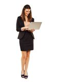 Woman Against White Background Using Laptop Royalty Free Stock Images