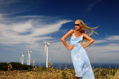 Woman against the wind turbines Stock Photography
