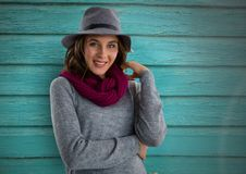 Woman against wood with warm scarf and hat Stock Images