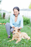 Woman in   age of   dog on   lawn. Royalty Free Stock Image