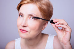 Woman age makeup Stock Image