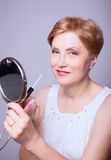 Woman age makeup stock images