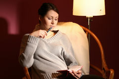 Woman with agenda. Girl, young woman sitting in armchair with agenda on her laps stock photos