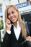 Woman Agent. A beautiful young real estate agent woman on the phone Stock Photos