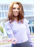 Woman Agent giving out a key Royalty Free Stock Image