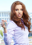 Woman Agent giving out a key Stock Images