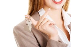 Woman agent holding the keys Royalty Free Stock Photography