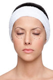 Woman agrees to make a facelift, closed eyes Stock Image