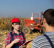 Woman agrnomist and farmer in the field Royalty Free Stock Image
