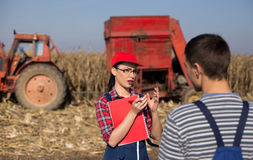 Woman agrnomist and farmer in the field Stock Image