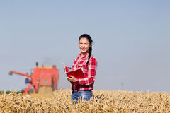 Woman agronomist in wheat field Royalty Free Stock Photo