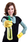 Woman aim at fictive target with cleaning spray Royalty Free Stock Photos