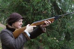 Woman aiming royalty free stock image