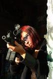 Woman aiming assault gun Royalty Free Stock Photos