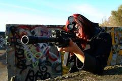 Woman aiming assault gun Stock Image
