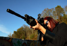 Woman aiming assault gun Royalty Free Stock Photo