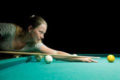 Woman aiming for billiard Royalty Free Stock Images