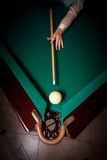 Woman aiming at billiard pocket with white ball Stock Image