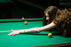 Woman aiming for the billiard table Stock Photos
