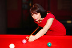 Woman aiming for the billiard table Royalty Free Stock Image