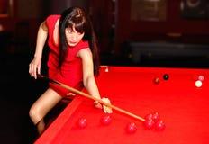 Woman aiming for the billiard table Stock Photos