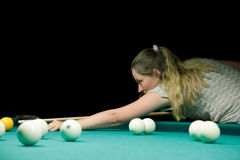 Woman aiming for billiard table Stock Photos
