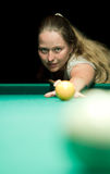 Woman aiming for billiard table Royalty Free Stock Image