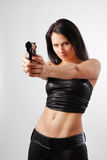 Woman aiming at close. Royalty Free Stock Photo