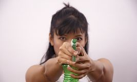 Woman aiming with PVC green spray bottle Stock Photos