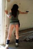 woman aiming with gun Stock Photo