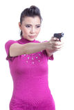 Woman aiming a gun Stock Image
