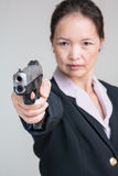 Woman aiming a hand gun Royalty Free Stock Photo