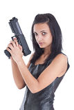 Woman is aiming a handgun Royalty Free Stock Photos