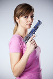 Woman aiming a handgun Royalty Free Stock Images