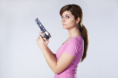 Woman aiming a handgun Stock Photos