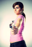 Woman aiming a handgun Royalty Free Stock Photos