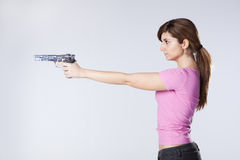 Woman aiming a handgun Stock Image