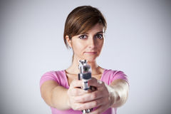 Woman aiming a handgun Royalty Free Stock Image