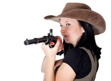Woman aiming with pistol in hand Royalty Free Stock Photos