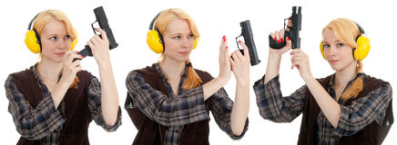 Woman aiming a pistol at shooting range Stock Photo