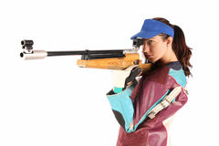 Woman aiming a pneumatic air rifle stock images