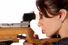 Woman aiming a pneumatic air rifle Stock Photos