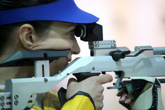 Woman aiming a pneumatic air rifle Royalty Free Stock Photos