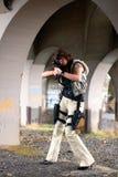 Woman aiming rifle Stock Image