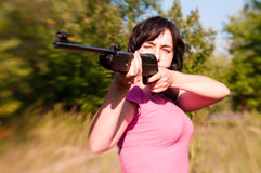 Woman aiming rifle in the summer Royalty Free Stock Photography